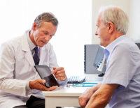 doctor explaining to the senior man