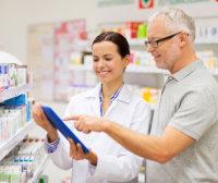 pharmacist and senior man smiling