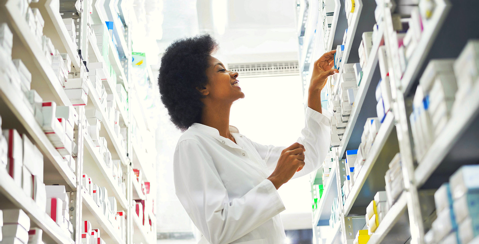 pharmacist checking the label