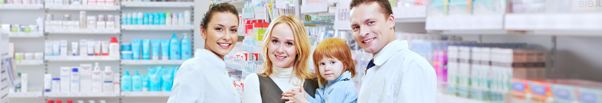 two pharmacist and the mother smiling