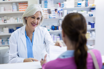 pharmacist giving prescription